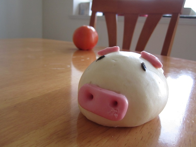 A bread moulded into the shape of a pig.