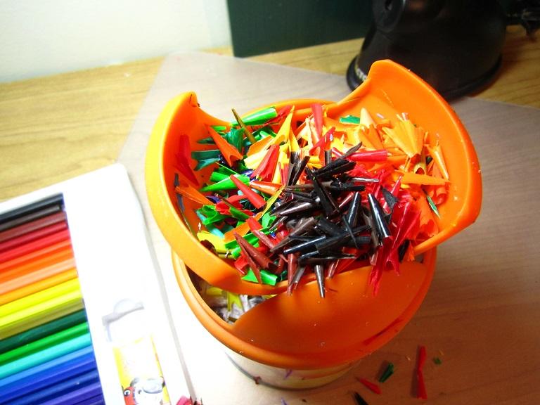 Multicolour crayon shreds.