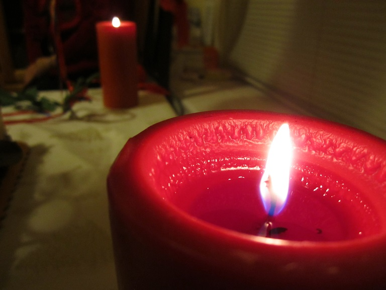 A macro picture of a burning candle.